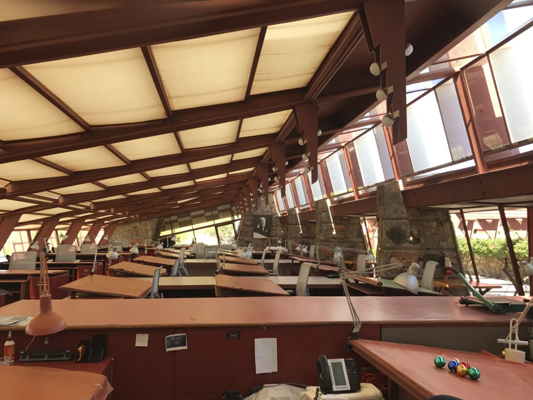 The drafting room at Taliesin West in Scottsdale, Ariz., the winter home of architect Frank Lloyd Wright and the architecture school he founded. Many of Wright's famous buildings were designed in this room, including the Guggenheim Museum in New York. Wright's students also mapped out their own creations on the sloping desks that look out at the desert through broad windows. (AP Photo/Anita Snow)