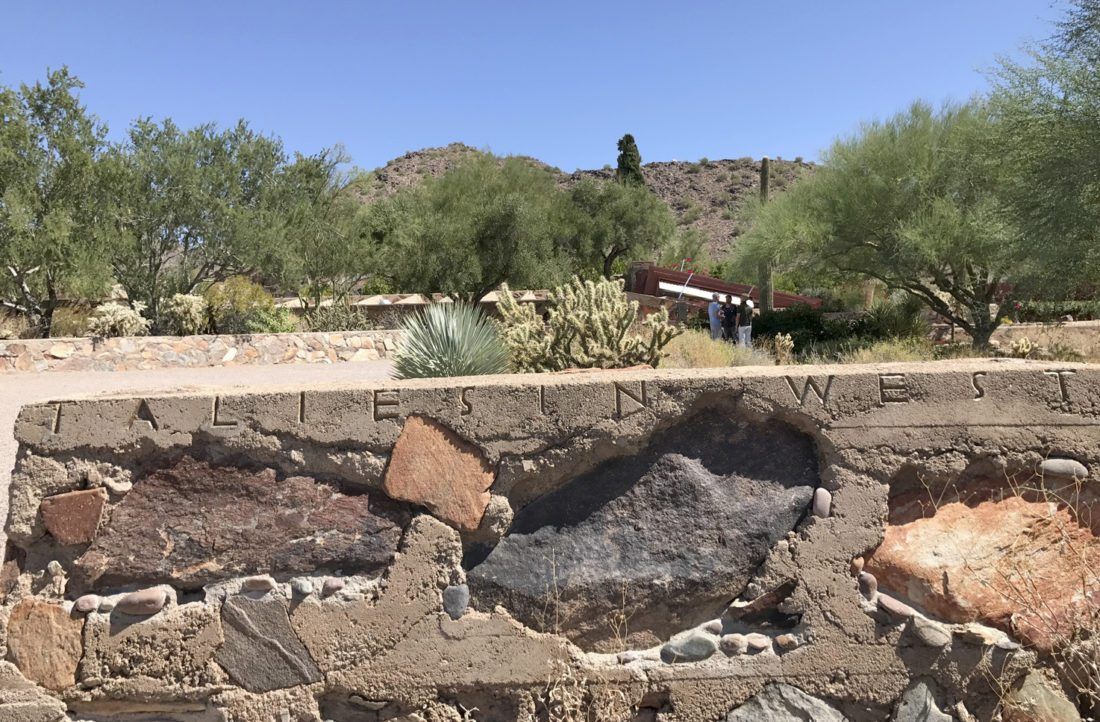 "The words ""Taliesin West"" are shown carved into a rock wall with the desert landscape visible in the background in Scottsdale, Ariz. The complex served as the winter home of architect Frank Lloyd Wright in Scottsdale, Arizona from 1937 until his death in 1959 at age 91. The original Taliesin, Wright's primary home in southwestern Wisconsin, where he was born, was named after a 6th century Welsh bard whose name means ""shining brow."" (AP Photo/Anita Snow)"