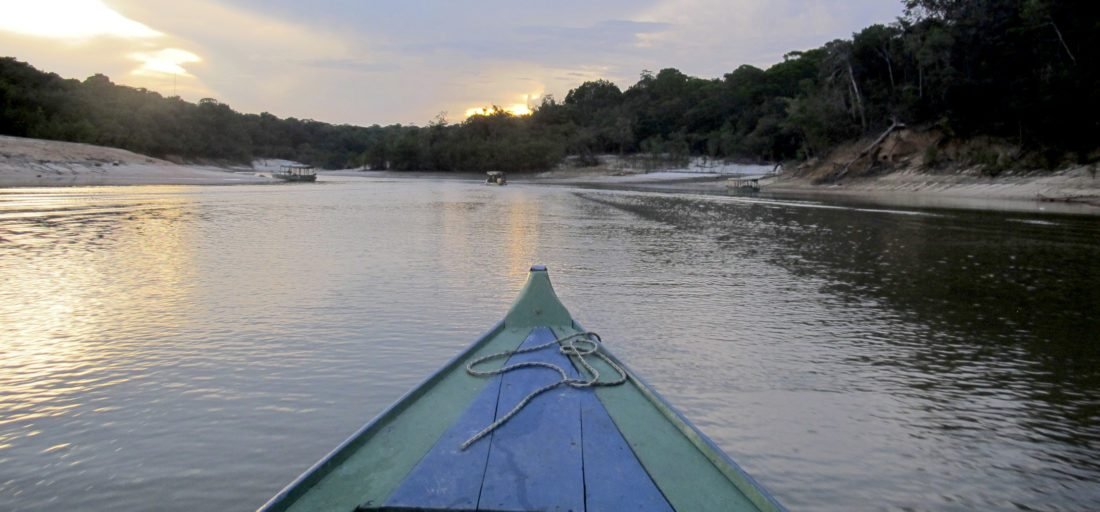 A sunset in the Amazon rain forest is seen from a tributary of the Rio Negro outside Manaus, Brazil. Boat travel is common throughout the Amazon basin, both for forest dwellers and tourists. (AP Photo/Peter Prengaman)