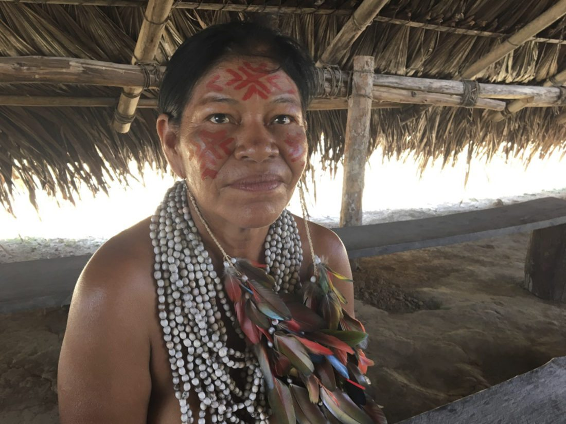 A member of the Dessena tribe poses for a picture in her village outside of Manaus, Brazil. The 100 people in the village live as they have for centuries, in small huts without electricity, running water or cellular photos. One modern twist is allowing tourists to visit and buy crafts. (AP Photo/Peter Prengaman)