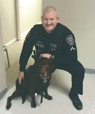 Charles Town Master Patrolman Jason Newlin with his K9 partner, Hyde. (Submitted photo)