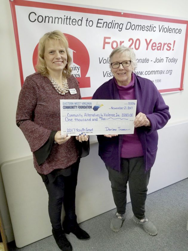 Eastern West Virginia Community Foundation Program Manager Karin Hammann Dunn (left) presented a $1,000 grant to Carolyn J. Zdziera, Executive Director Community Alternatives to Violence.  (Submitted photo)
