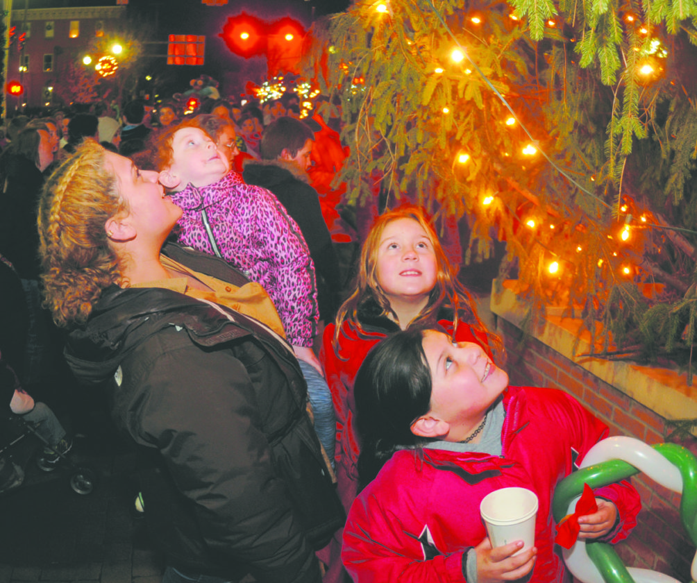02 MB Tree Light4 ra 12-01-17 From left: Adriana Medrano, Felicity Messicki, 5, jayla Messick, 9 and Alessia griffin, 8 marvek at teh Martinsburg Christmas tree as the lights come on at the Martinsburg Tree Lighting event in Martinsburg Square Friday night. (Journal Photo by Ron Agnir)