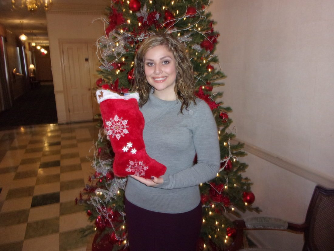 Journal photo by John McVey Misti Kidwell, of Brown's Funeral Home in Martinsburg, displays one of the Christmas stockings stuffed by a member of the community that will be delivered to veterans at the VA Medical Center.