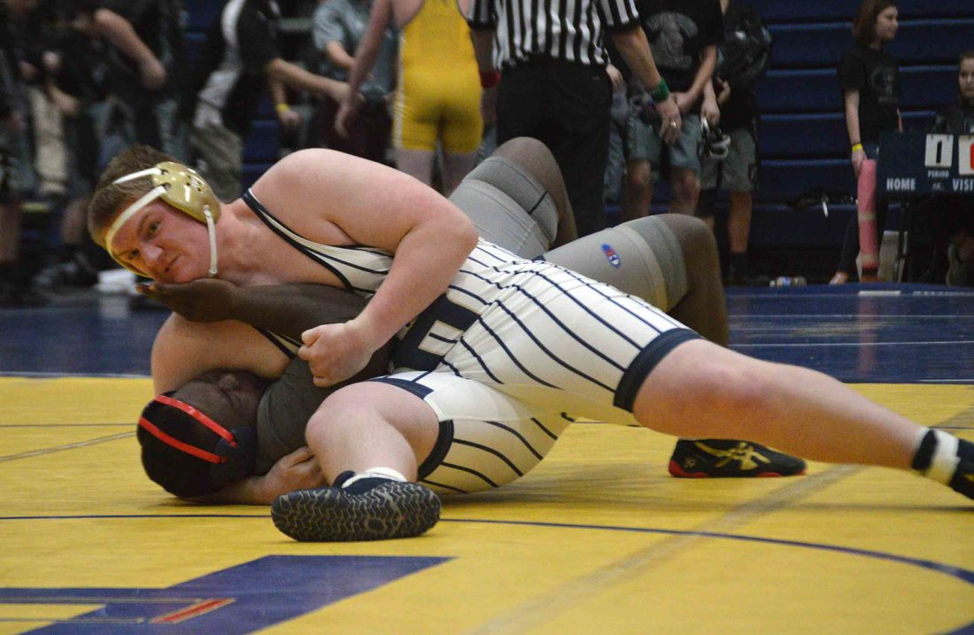 Journal photo by Jessica Manuel-Wilt Hedgesville's Daniel Sherrard, top, pins Spring Mills' Fazon Hunter during their 285-pound match at the Hedgesville Duals on Friday.