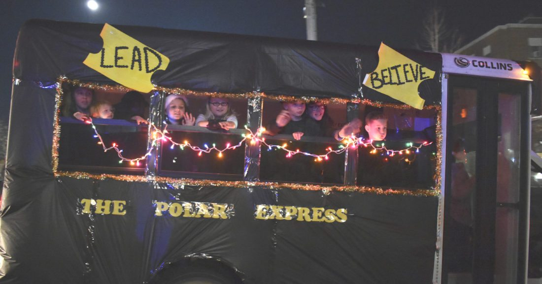 Journal photo by Clarissa Cottrill  Children from Little Eagle Child Care Center travel in a 'Polar Express' during the Christmas Parade in Martinsburg Dec. 2, 2017.