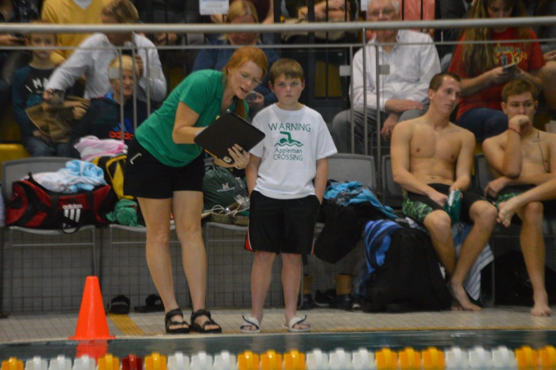 Journal photo by Jessica Manuel-Wilt Luke Bender, right, gets instructions from Musselman swimming coach Mindy Hull on Saturday. Bender was the Applemen's special coach for the meet.