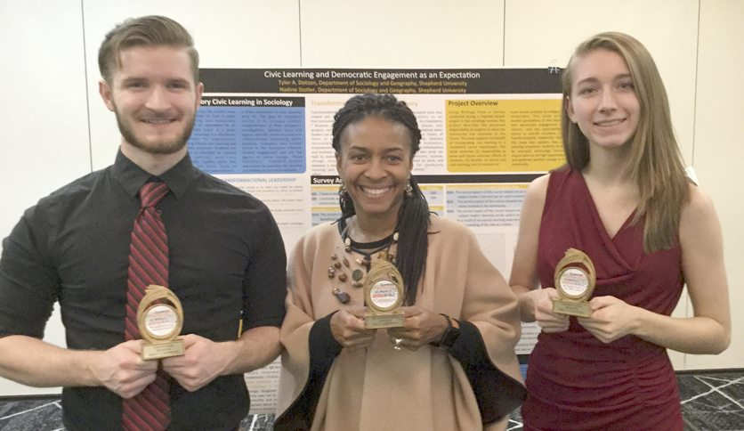 Pictured receiving trophies are , from left, Tyler A. Dotson, a sociology major from Martinsburg; Dr. Chiquita Howard-Bostic, chair of the Department of Sociology and Geography; and Nadine Stotler, a psychology major from Martinsburg. (Photo courtesy of Shepherd University)