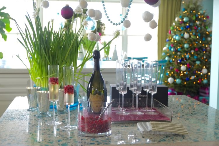 To bring a subtle sparkle to holiday entertaining, Massachusetts-based interior designer Kristina Crestin added a few mercury glass votive holders and a cluster of paperwhite plants in silver-toned metal pots to a champagne bar, and included sheets of metallic paper in a tray beneath the champagne glasses. (AP photo)