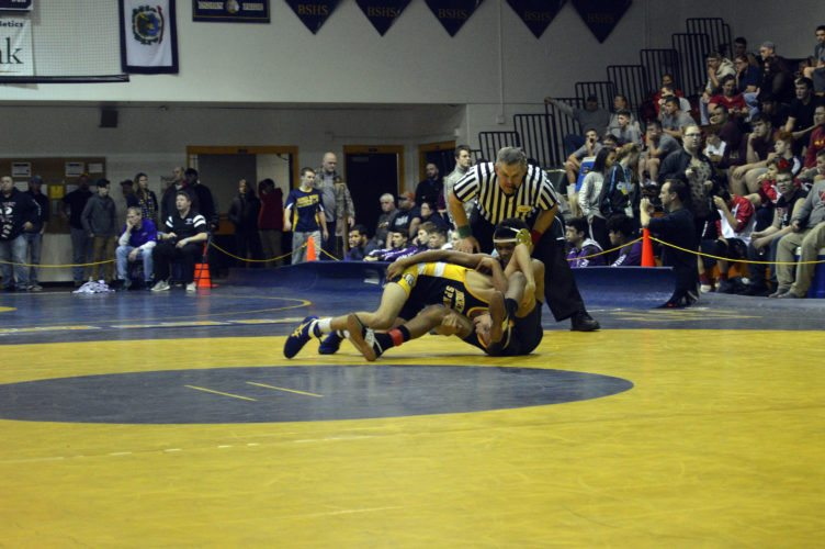 Journal photo by Jessica Manuel-Wilt Berkeley Springs' Lee Nicholson, front, wrestles Hedgesville's Jaheim Broadus in a 106-pound consolation match at the 33rd-annual Max Horz tournament on Friday night in Berkeley Springs.
