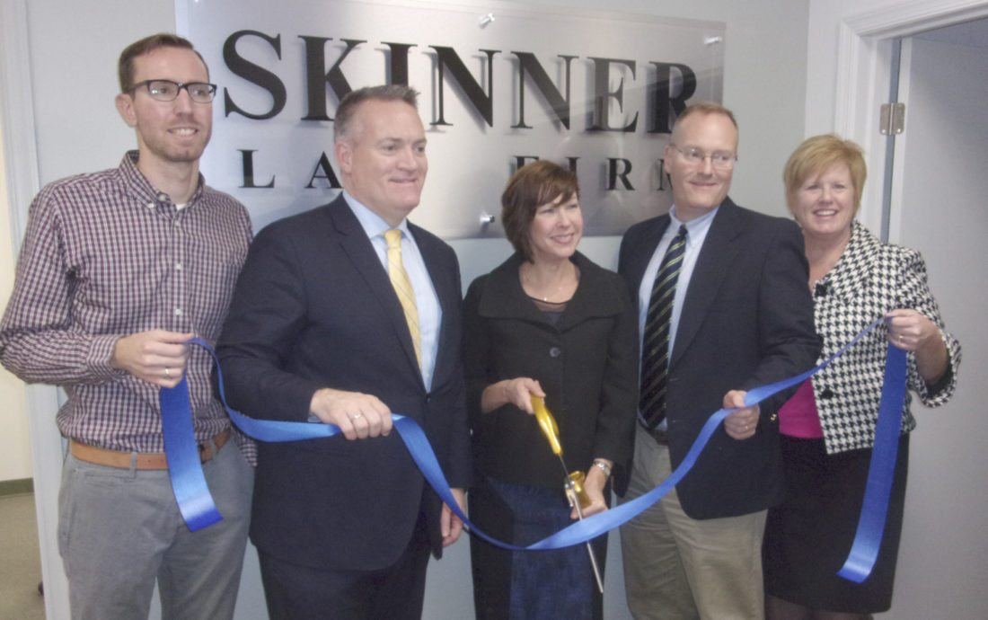 From left, Jeffrey Gustafson, marketing director; Stephen Skinner, principal; Laura Davis, attorney; Andrew Skinner, principal; and Tina Combs, president and CEO, Martinsburg-Berkeley County Chamber of Commerce, at the grand opening ribbon cutting for the Skinner Law Firm's new offices at 261 Aikens Center in Martinsburg. (Journal photo by John McVey)