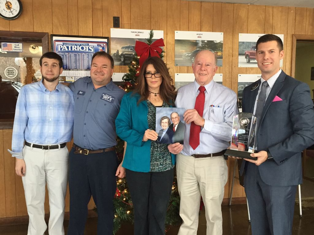 Shown, from left are members the Chicchirichi family, Timmy Carson, Gary Chicchirichi, II, Stacey Carson, Gary Chicchirichi (holding a photo of his  father Guy and Eleanor Chicchirichi) as Gary receives recognition of his 50 years of service to General Motors from Steven Brewer, GM zone manager. (Submitted photo)