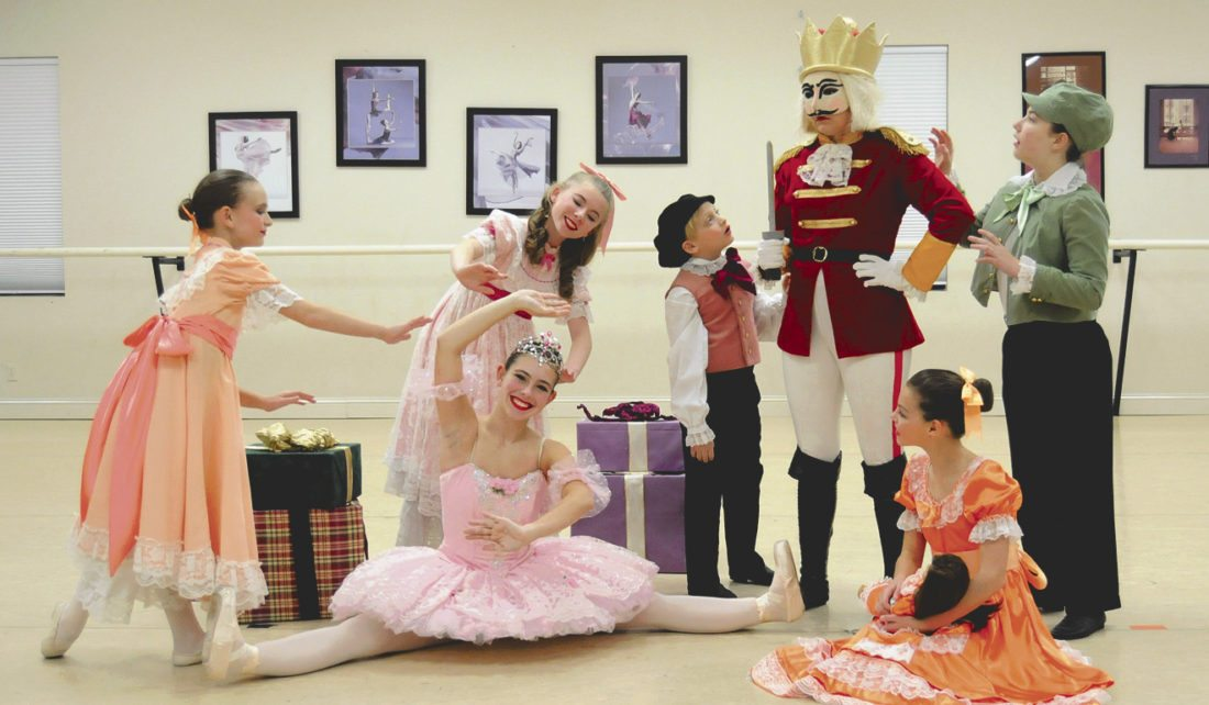 Anna Grace Cox (Clara), Grace Bridges (Sugar Plum Doll), Ben Reynolds (Fritz) and  Sydney Painter (Nutcracker Doll) prepare for the Inwood Dance Company's Nutcracker. (Journal photo by Ron Agnir)