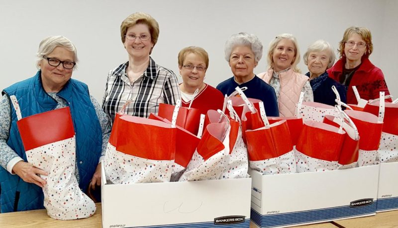 DAR members Diane Steece, Cheryl Brown, Darla Ambrose, Marie Snowden, Marianne Caruso, Barbara Nickell and Lois Kimble help stuff stockings for veterans (Submitted photo)