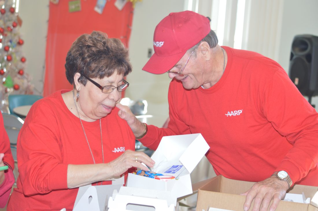 Journal photo by Adranisha Stephens Members of the Martinsburg AARP chapter prepare blizzard boxes at the Berkeley Senior Services Center Wednesday.