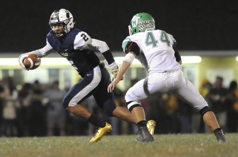 Hedgesville's Malakai Brown, left, tries to run past the defense of Musselman's Jacob Northcraft during their regular-season game on Oct. 6. (Journal file photo by Ron Agnir)