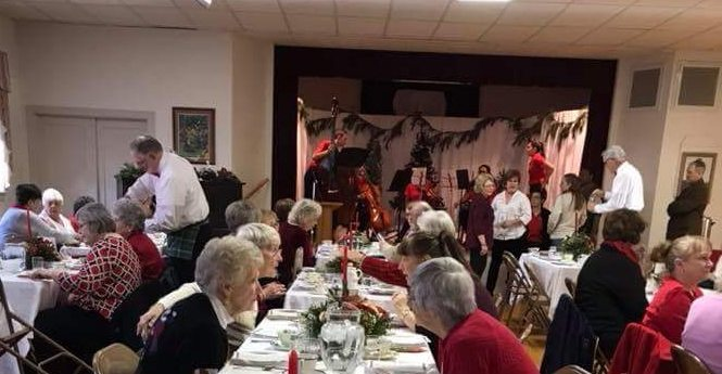Ladies at the Otterbein United Methodist Church Christmas Tea share stories. (Submitted photo)