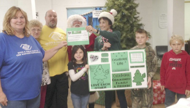 Submitted photo Elaine Park, center with hat, presents a check to the Boys and Girls Club of Morgan County to provide holiday gifts to teens beyond the age limit of most giving programs.