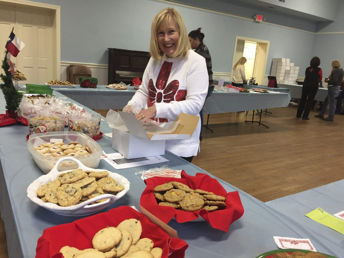 Photos by Toni Milbourne Deborah Fleming arranges trays of cookies for the Cookie Walk fundraiser in Harpers Ferry.