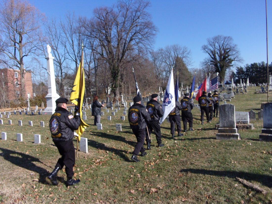 Journal photos by Tabitha Johnston Jefferson County Honor Guard prepares to Post the colors on Saturday at Edge Hill Cemetery's wreath-laying ceremony.
