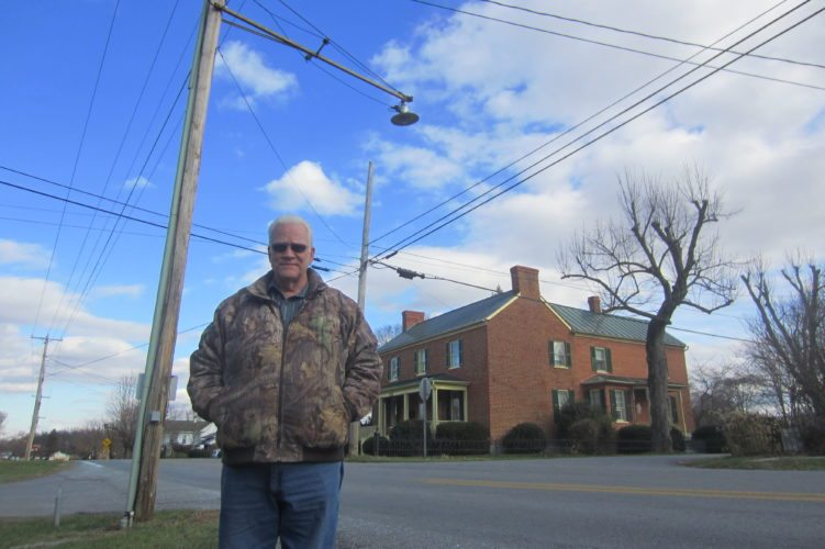 Journal photo by Tim Cook Mike Dick, a treasurer of Summit Point's informal street committee, helps ensure the unincorporated town's streets lights keep shining bright.