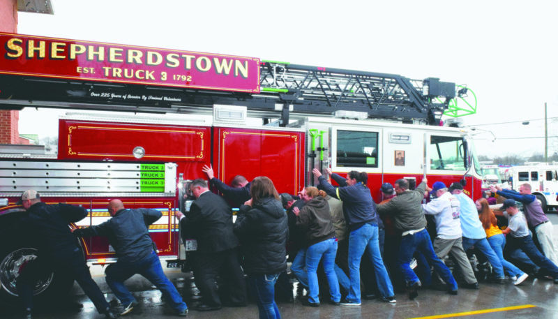 "Journal photo by Kelsie LeRose Members of the community join members of the Shepherdstown Volunteer Fire Department to ""push in"" Truck Three."