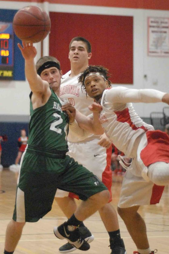 Journal photo by Eric Jones Hampshire's Trevor Evans, left, and Spring Mills' Christian Henson, right, and  Mason Caldwell, middle, battle for control of a loose ball Tuesday night in Spring Mills. See more photos on cu.journal-news.net.