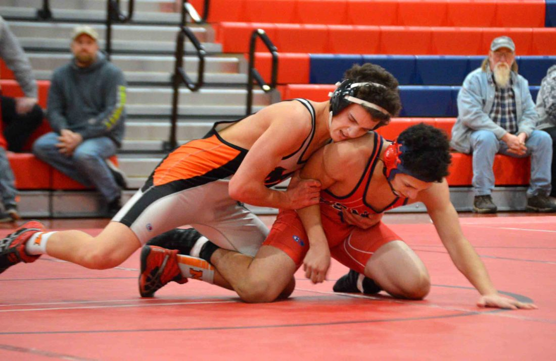 Kurt Resch of Martinsburg, left, is locked up on the mat with Javier Diaz of Spring Mills at 145 pounds during a triangular on Wednesday. (Journal photo by Jessica Manuel-Wilt)