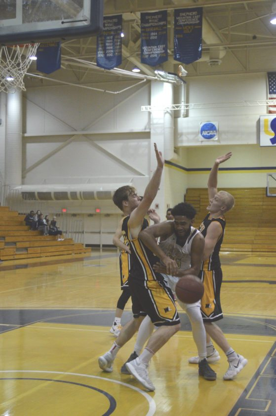 Shepherd's A.J. Carr fights through defense by West Liberty during their game on Dec. 6.  (Journal photo by Jessica Manuel-Wilt)
