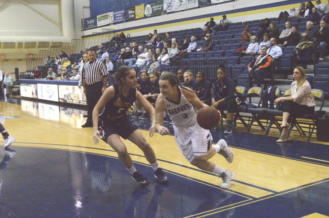 Shepherd's Morgan Arden, right, drives past Goldey-Beacom's Mara Poch during their game on Nov. 14. Arden, who has been a key scorer for the Rams during her time on the court, recently become the program's all-time leading scorer.