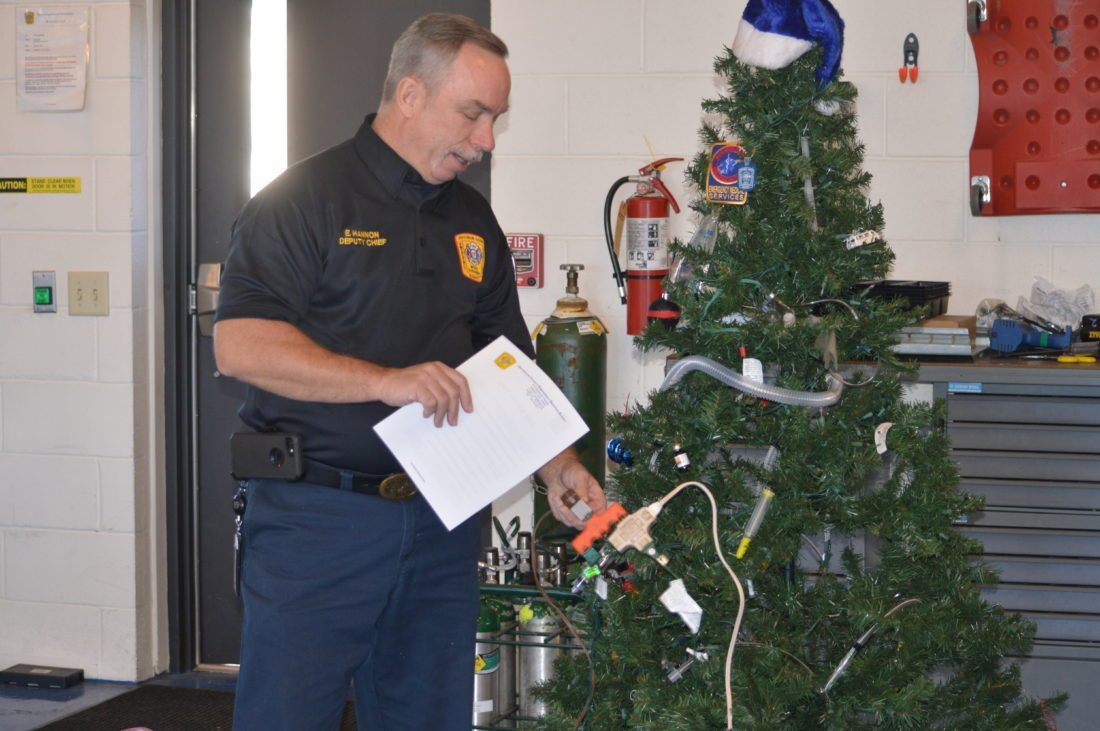 Journal photo by Adranisha Stephens Ed Hannon, deputy chief of the Jefferson County Emergency Services Agency, presents holiday season fire safety tips on Thursday.