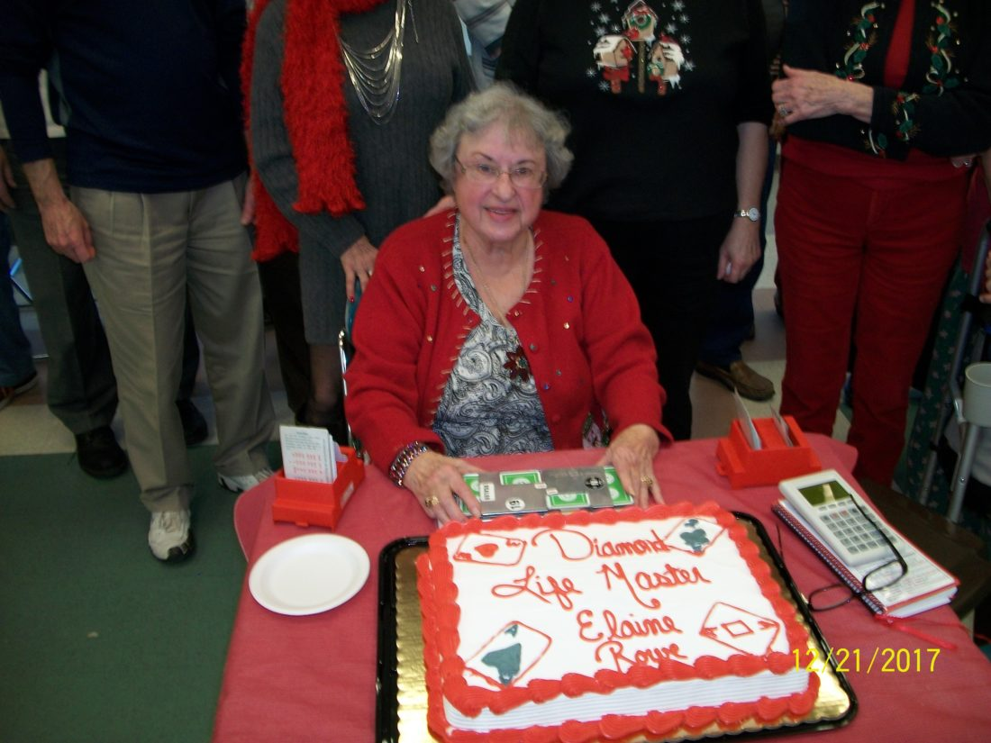 Elaine Rowe, from Hagerstown, celebrates her rank of Diamond Life Master at the Martinsburg Duplicate Bridge Club's Christmas party. (Submitted photo)