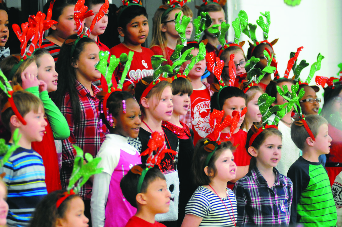 "2nd graders sing""A  Holiday of Music"" at the Tuscarora Elementary School Holiday Concert Thursday evening in Martinsburg. See more photos on CU.journal-news.net. (Journal Photo by Ron Agnir)"