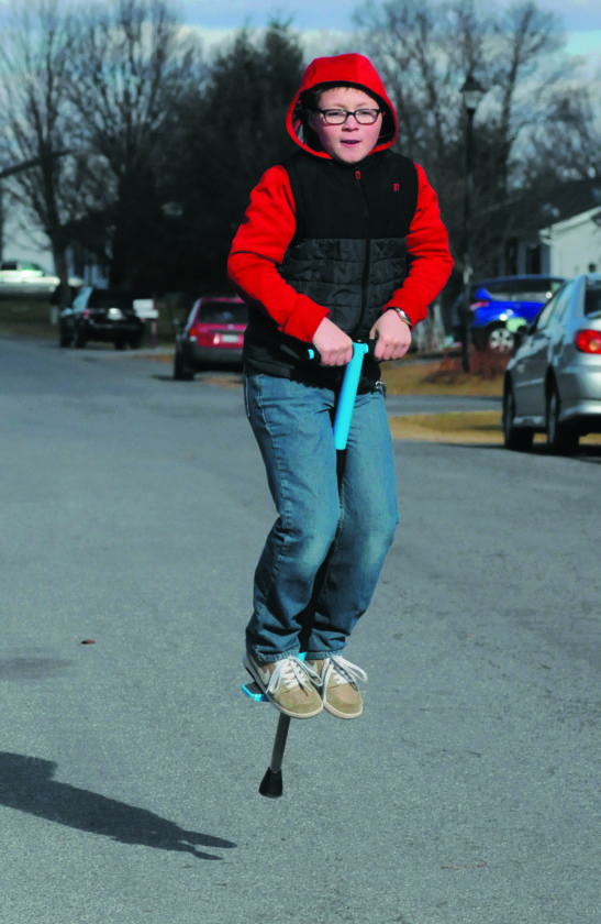 26 Xmas Pogo ra 12-25-17 Van Benjamin, 10 yrs old, tries out his new Christmas Pogo Stick on Cashmere Dr. Monday afternoon in Martinsburg. (Journal Photo by Ron Agnir)
