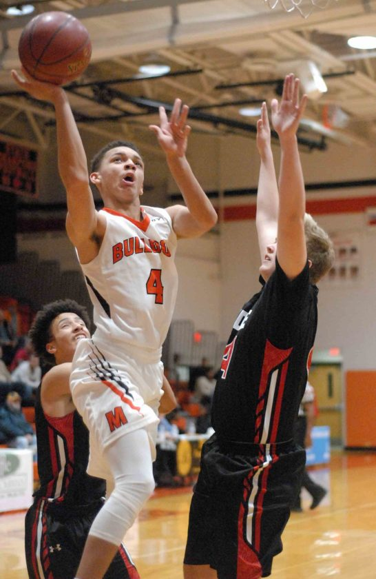 Martinsburg's Qualeke Bush, left, goes up for a layup against Heritage, Virginia, during the first half of their game during Skip Fowler Tournament on Thursday.