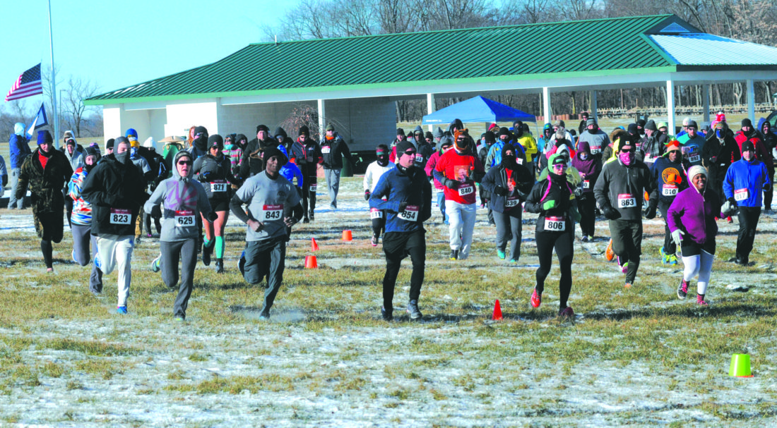 02 Rotary 5K1 ra 01-01-18 Runners, joggers and walkers take off in 15 degree weather for the start of the 2nd Annual Rotary 5K Run/Walk in Sam Michaels's Park in Harpers ferry Mondaay morning. All funds raised go to supporting the Rotary Club of Charles Town and Bros and Bras. (Journal Photo by Ron Agnir)