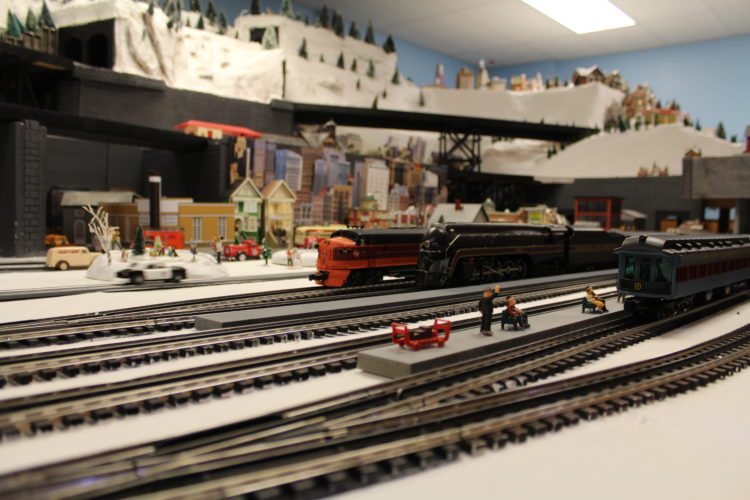 Several model railroads that run on simultaneous level through tunnels, towns and mountains. (Journal photo by Tricia Lynn Strader)