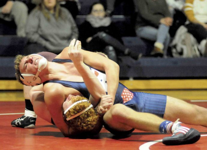Washington's Conor Wogan, top, strains on his way to defeating Jefferson's Kaleb Snyder in their 195-pound match Wednesday evening in Charles Town. See more photos on CU.journal-news.net.  (Journal photo by Ron Agnir)