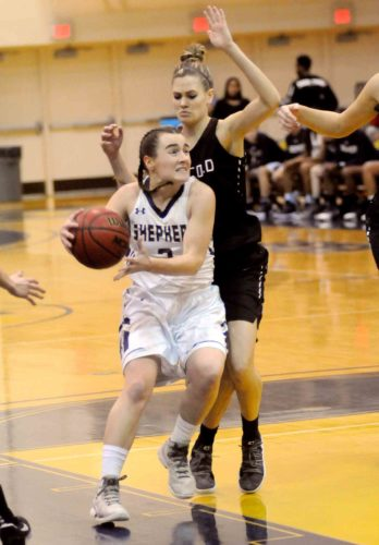 Shepherd's 5-foot5 Morgan Arden drives past Concord's 6-0 Madison May on her way to 40 points on Thursday. (Journal photo by Ron Agnir)