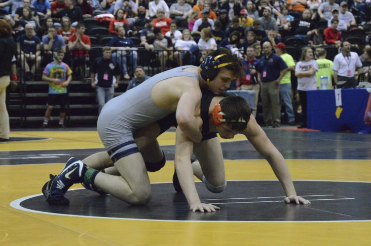 Berkeley Springs' Davy Mundey, top, has control during his match against Wirt's Hunter Moore during the 2017 Class A-AA state tournament. Mundey recently earned his 200th career win.