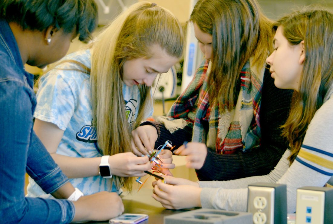 Sidney Hepner, Tiffany Henry and Raelyn Jones and Madeline Bozenko, students at Spring Mills High School, fly Flybrix drones at BRCTC. (Journal photo by Adranisha Stephens)
