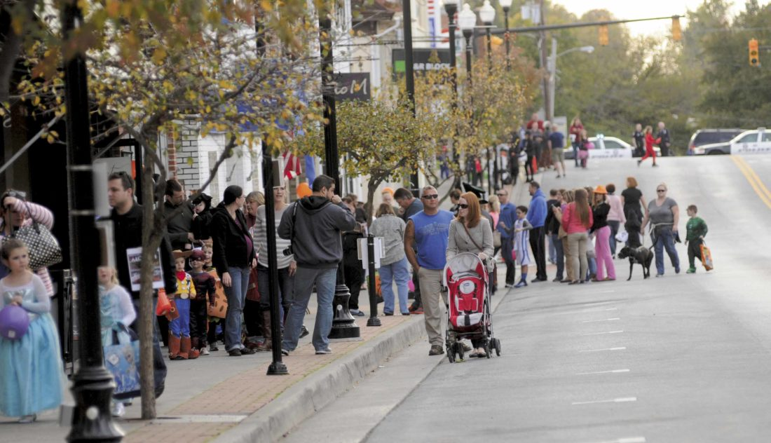 People walk the streets of downtown Charles Town. Charles Town was recently listed as the fourth safest city in the state, according to one study. (Journal file photo by Ron Agnir)