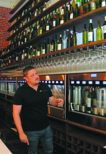 12 Brix 27-1 ra 01-11-18 Drew Johnson next to the wine bar at Brix 27 in Martinsbiurg. (Journal Phtoo by Ron Agnir)