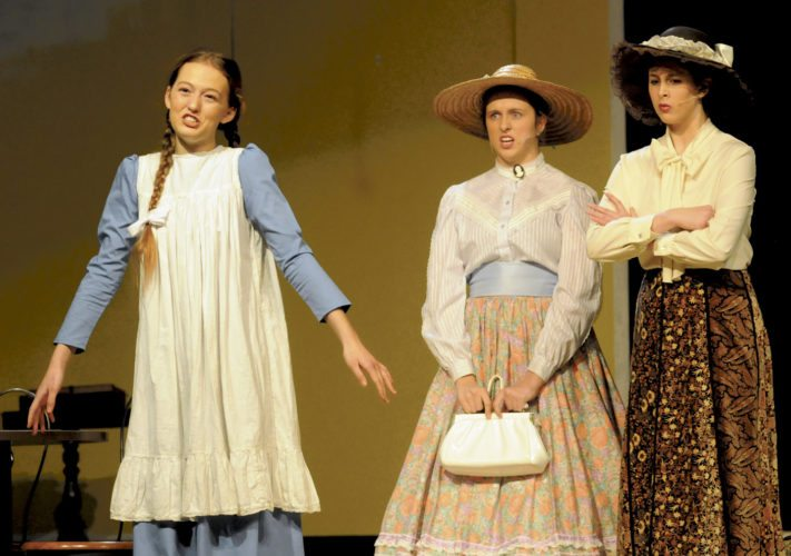 From left: Anne Shirley (Monica Power) shocks Mrs. Rachel Lynde (Maggie Denton) and Marilla Cuthbert (Charity Turley) with her active imagination in Anne of Green Gables at the SMHS Theatre.  (Journal Photo by Ron Agnir)