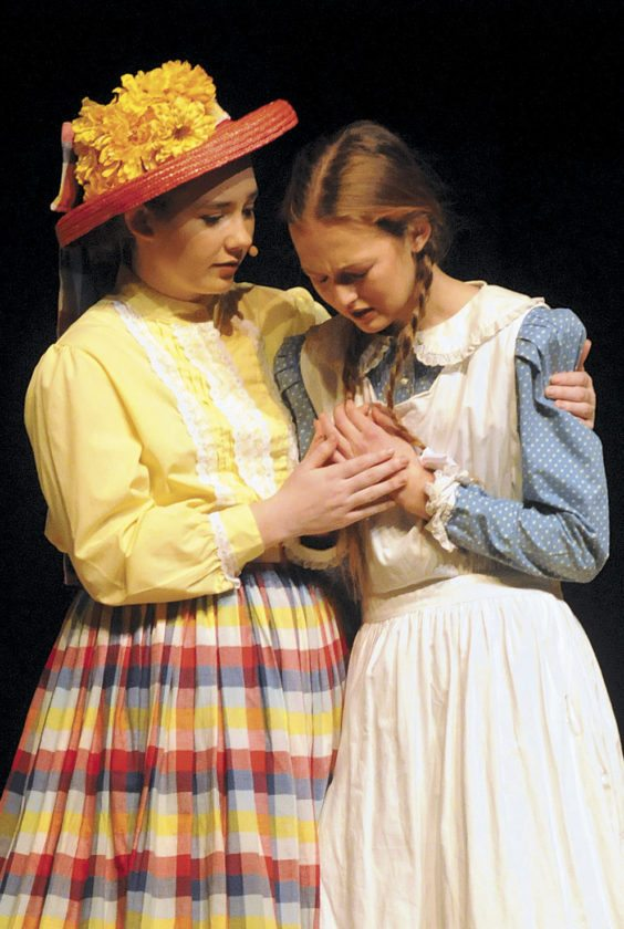 Diana Barry (Elleanna Stoner) and Anne Shirley (Monica Power) are best friends in Anne of Green Gables at the SMHS Theatre.  (Journal Photo by Ron Agnir)