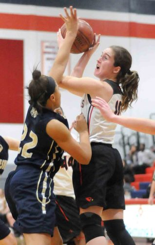Spring Mills' Emily Garland shoots over Hedgesville's Lexiey Maynard the first half of the Cardinals' victory on Thursday. See more photos on CU.journal-news.net.  (Journal photo by Ron Agnir)