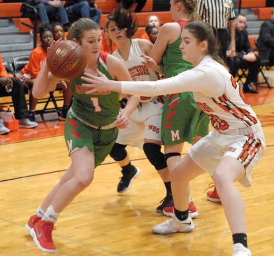 Allison Burdette of Musselman drives against Martinsburg's Kylie Roberts. (Journal photo by Eric Jones)