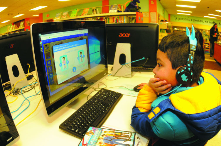 Sayam Seyad, 7, learns about ABC's on a computer at the Martinsburg Public Library last Wednesday afternoon. (Journal Photo by Ron Agnir)