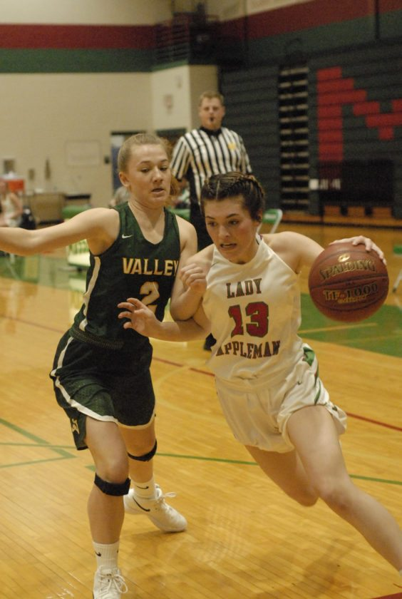 McKinzie Matheson of Musselman drives the ball against Loudoun Valley's Sarah Thompson during Saturday's contest. (Journal photo by Jessica Manuel-Wilt)