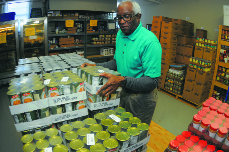 22 CCAP1 ra 01-18-18 Morris Hosby works in the CCAP/Loaves and Fishes Food Pantry Thursday morning in Martinsburg. (Journal Photo by Ron Agnir)